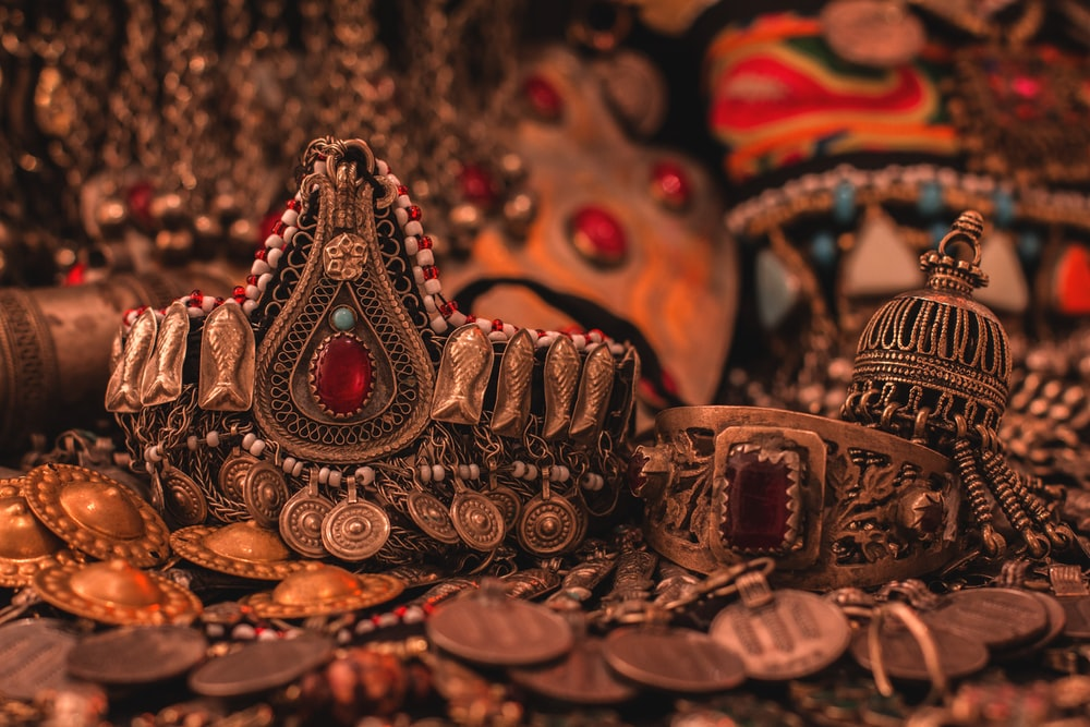 gold and red crown on brown wooden table