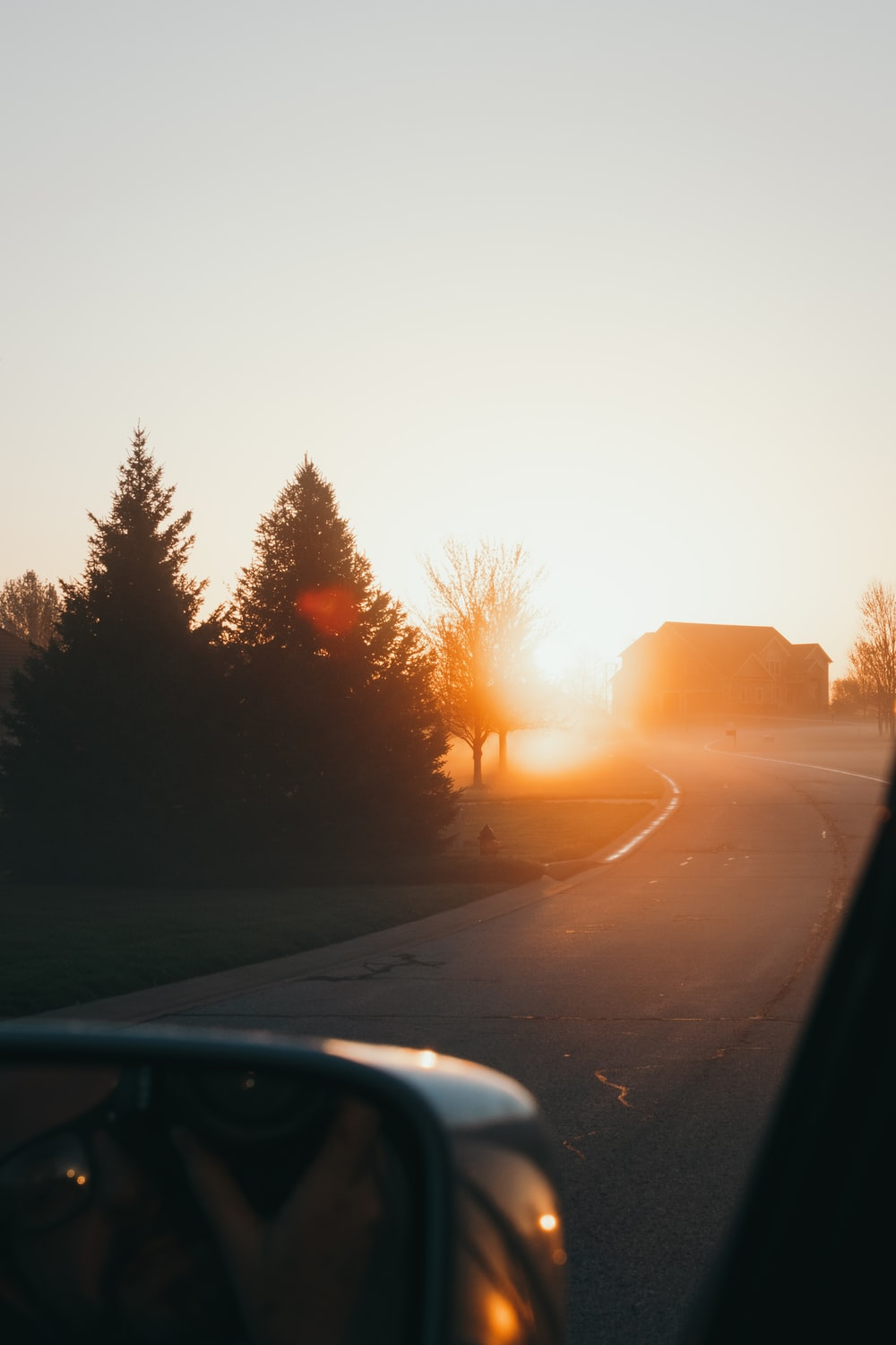car on road during sunset