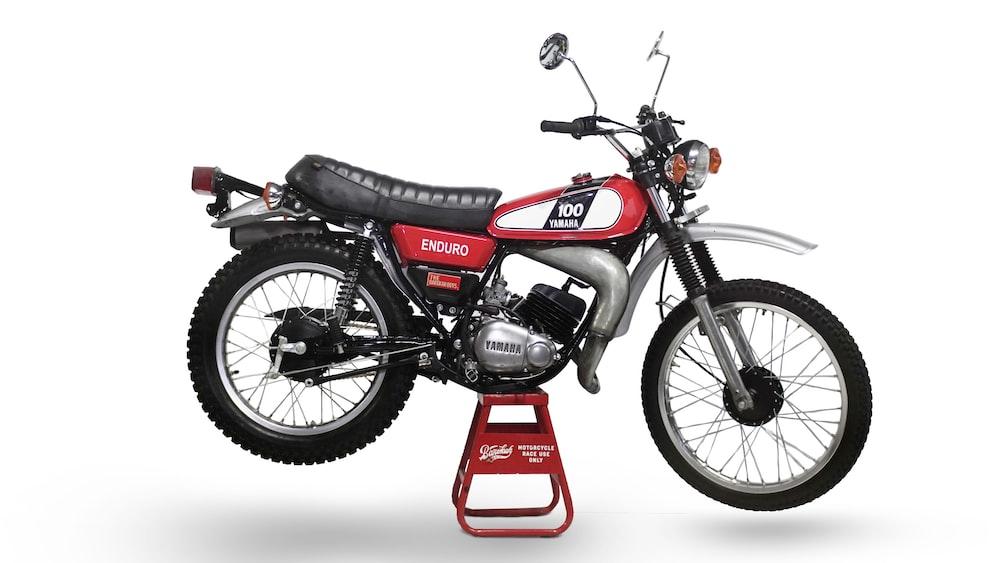 red and black honda motorcycle