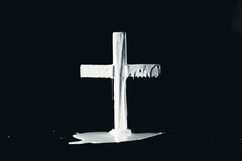 black cross with white background