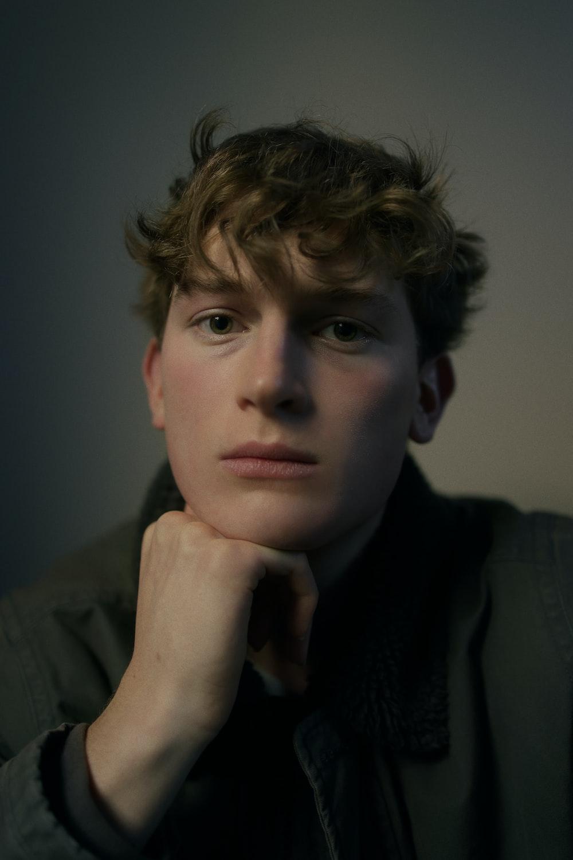 boy in black suit jacket