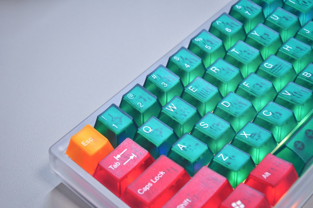 green and orange plastic lego blocks