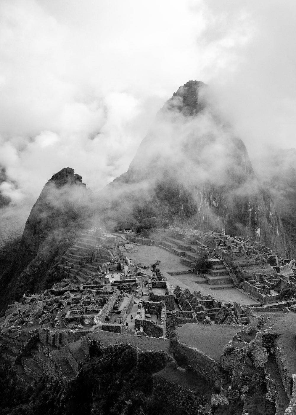 grayscale photo of mountain with smoke