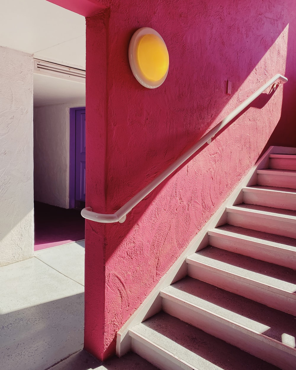 red and blue concrete staircase
