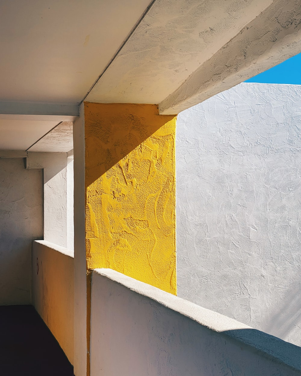 white and yellow concrete wall