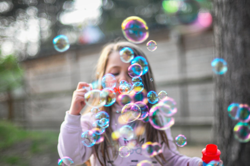 person holding bubble during daytime