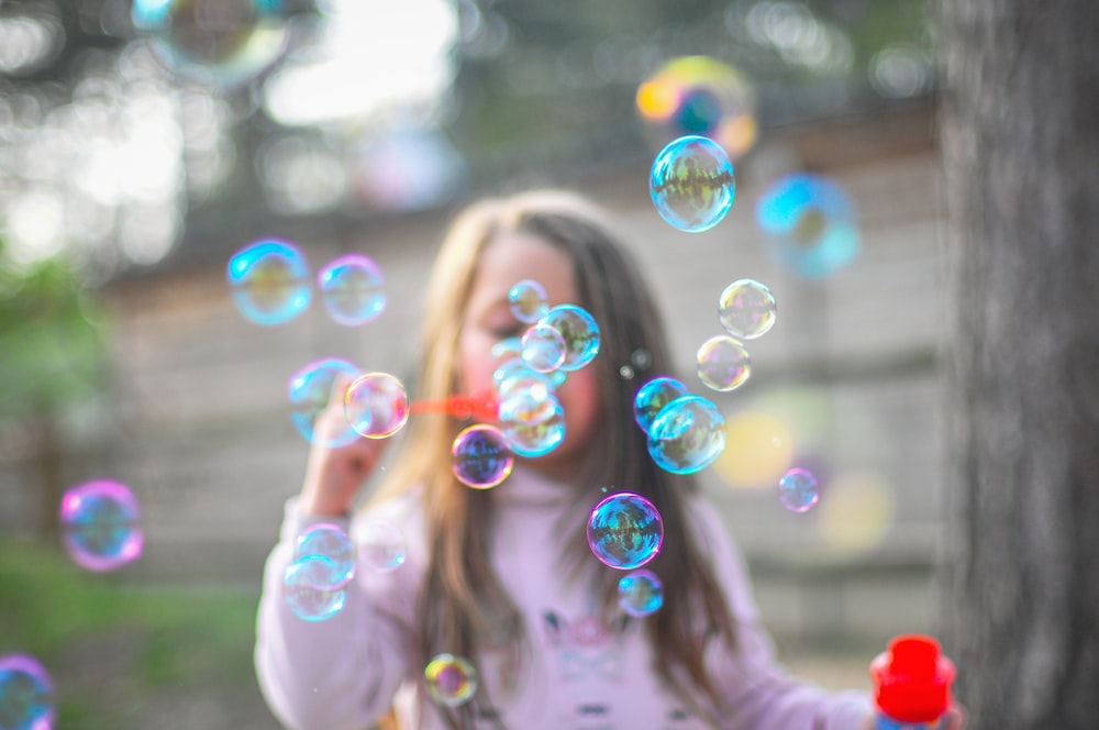 selective focus photography of bubbles