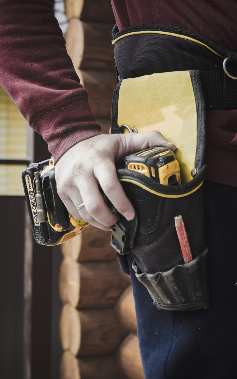 person holding black and yellow nike gloves
