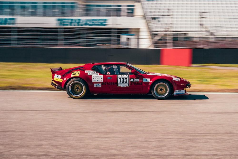 red porsche 911 on track field
