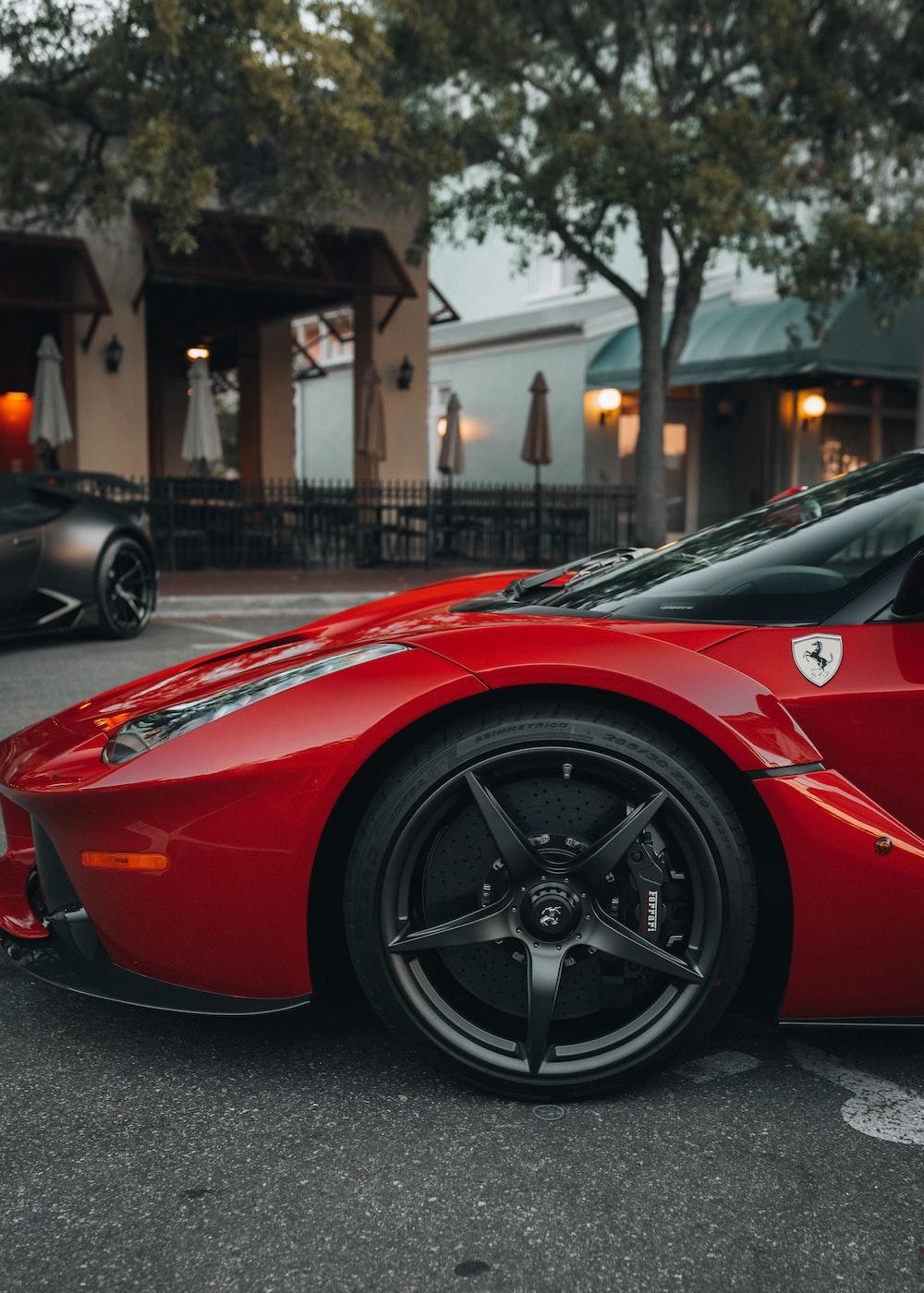 red ferrari 458 italia parked on street during daytime