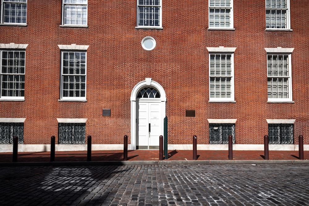 brown brick building with white door