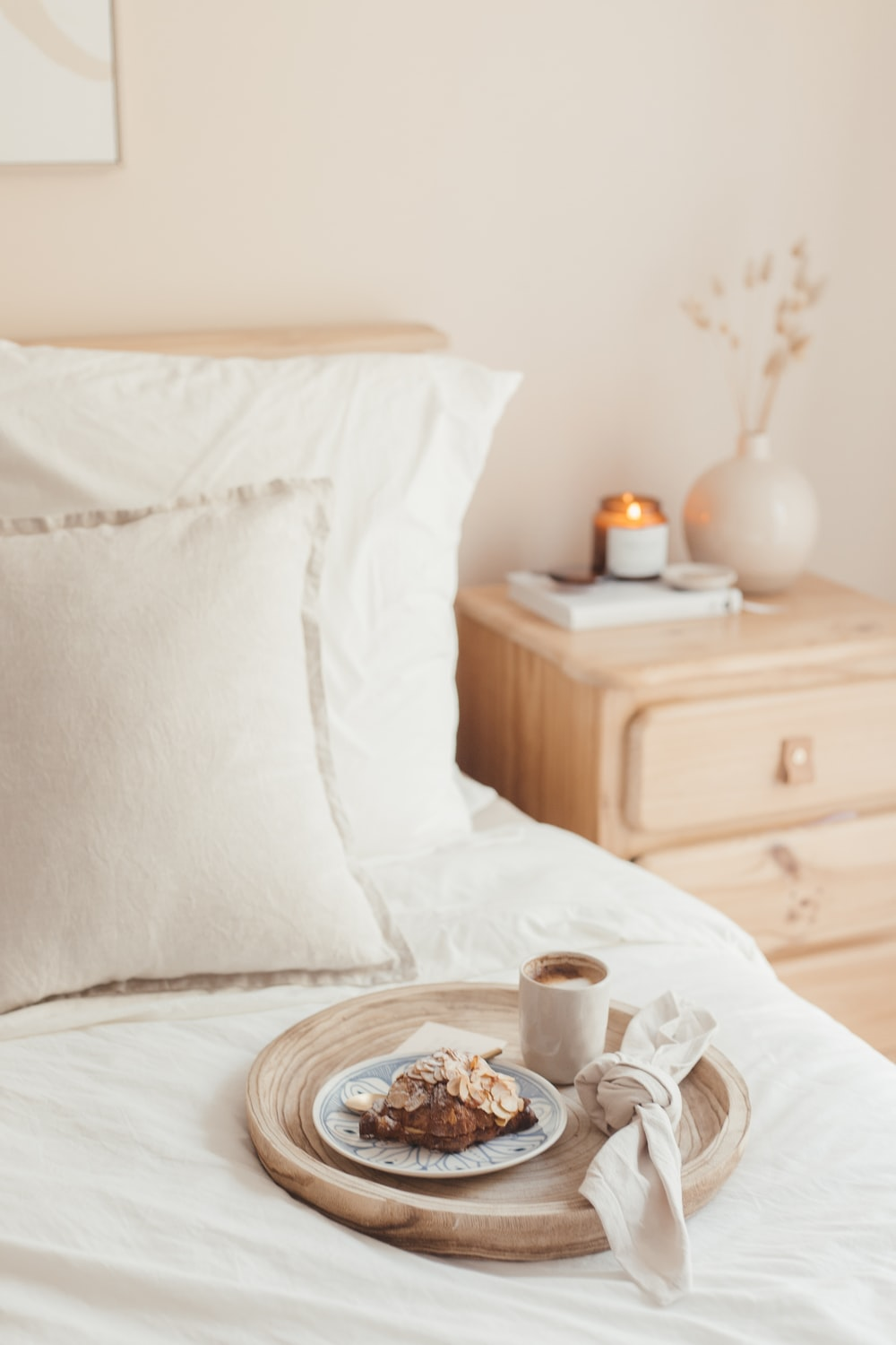 white and brown ceramic mug on brown wooden round table