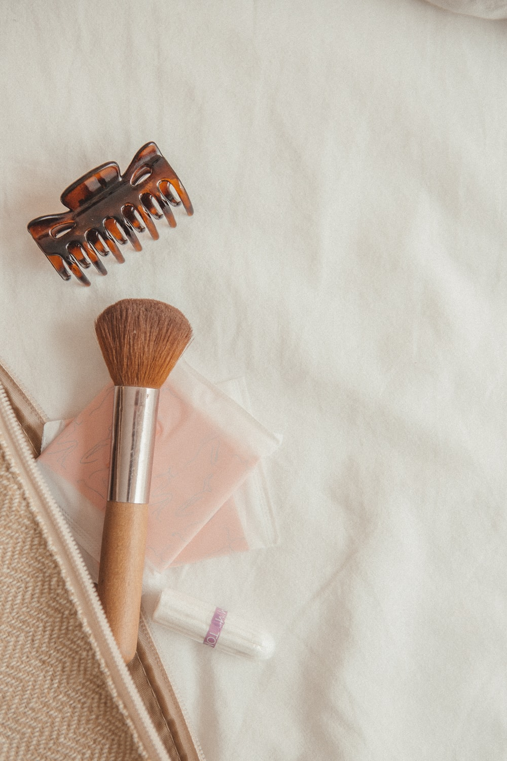 brown and silver makeup brush