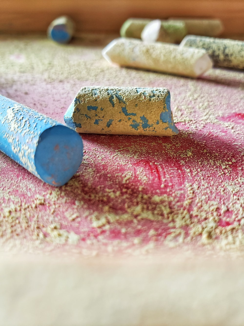 blue and brown rolled paper on pink and white textile
