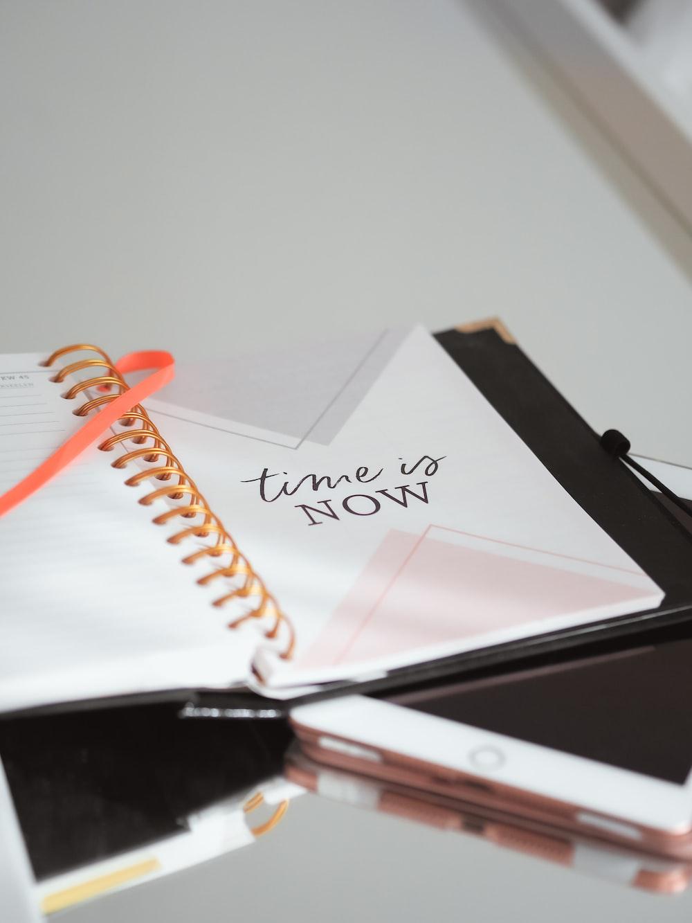 white ipad on white notebook