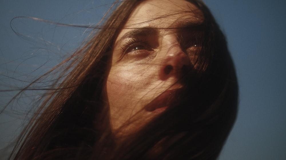 woman with brown hair taking selfie