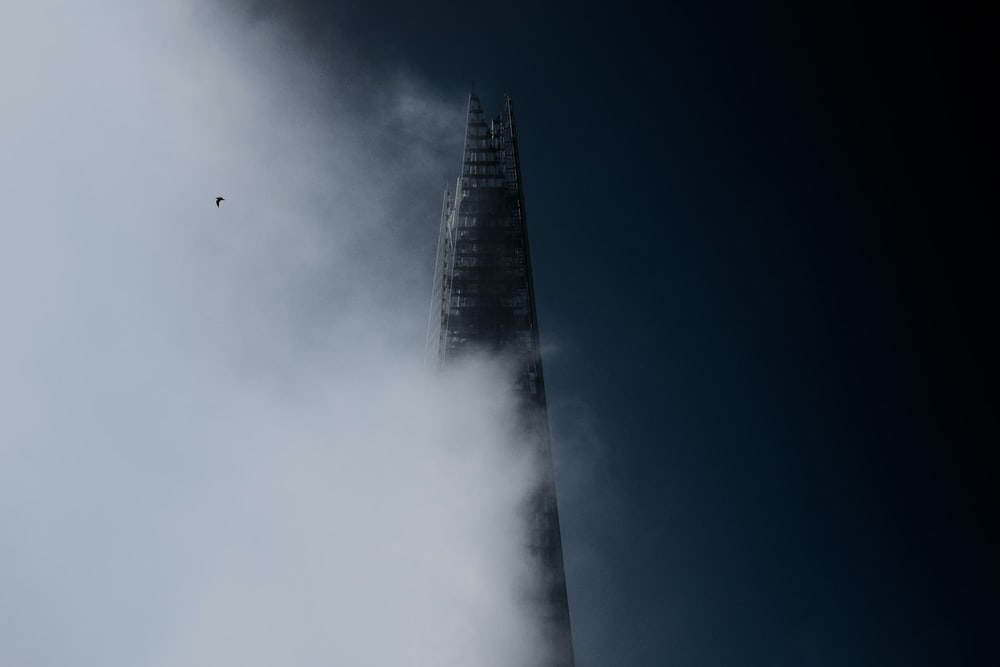 high rise building under white clouds
