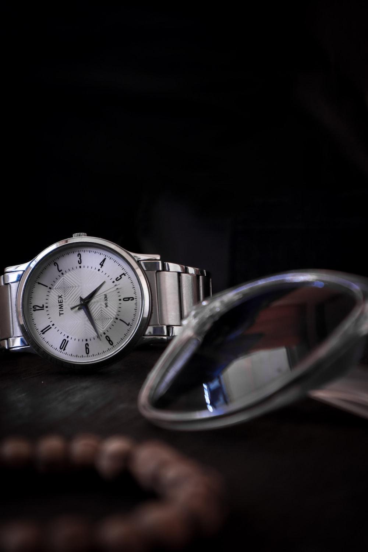 silver round analog watch at 10 00