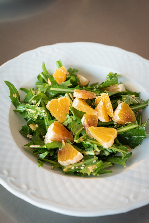 sliced orange fruits on white ceramic bowl