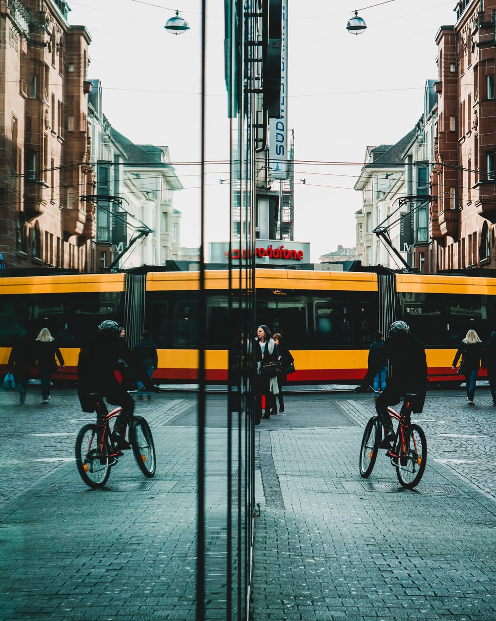 yellow and black bus on road during daytime