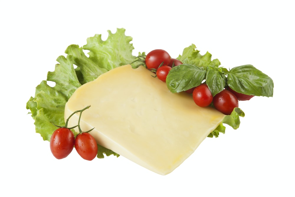red tomatoes beside white cheese