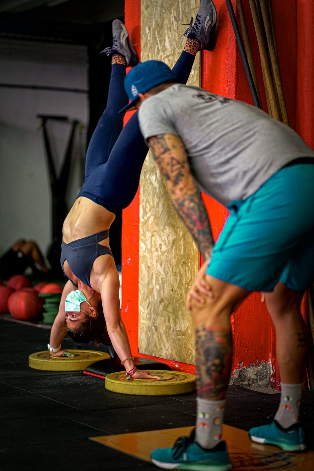 man in gray shirt and blue shorts doing yoga