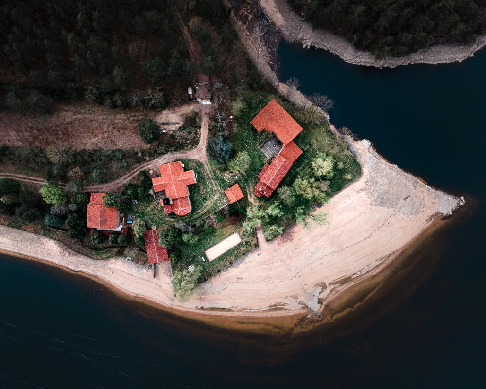 aerial view of brown and white house on cliff
