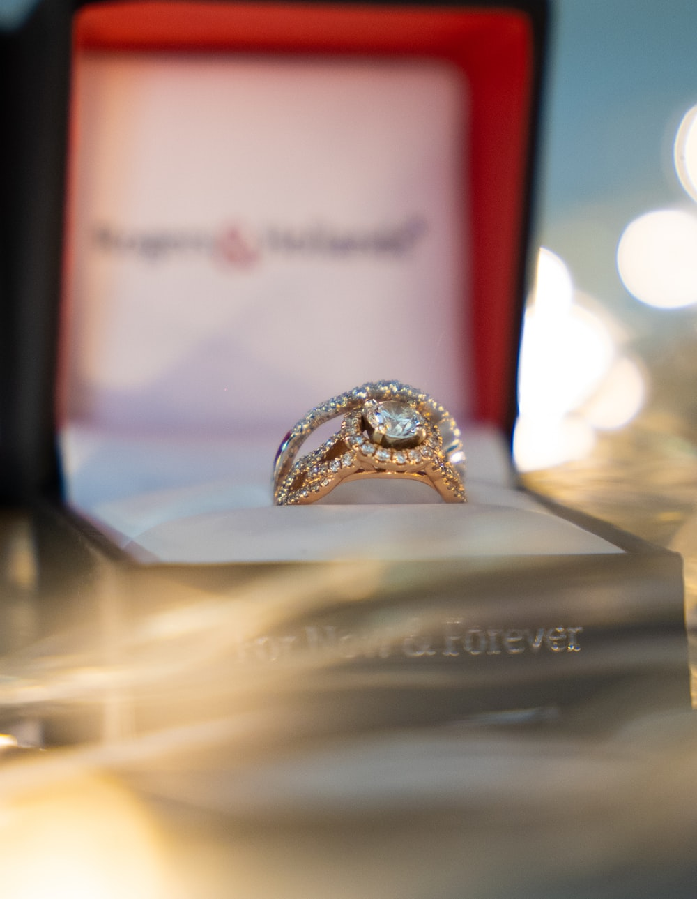 silver diamond ring on gold ring