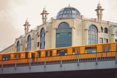 Berlin yellow and black train on rail