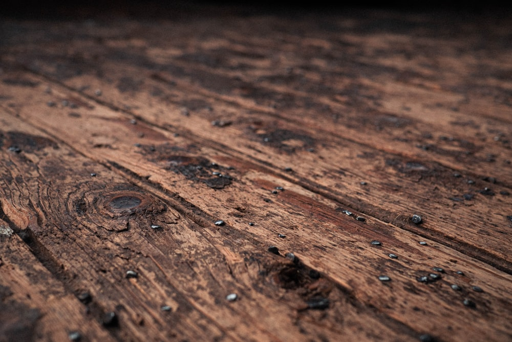 water droplets on brown wooden surface