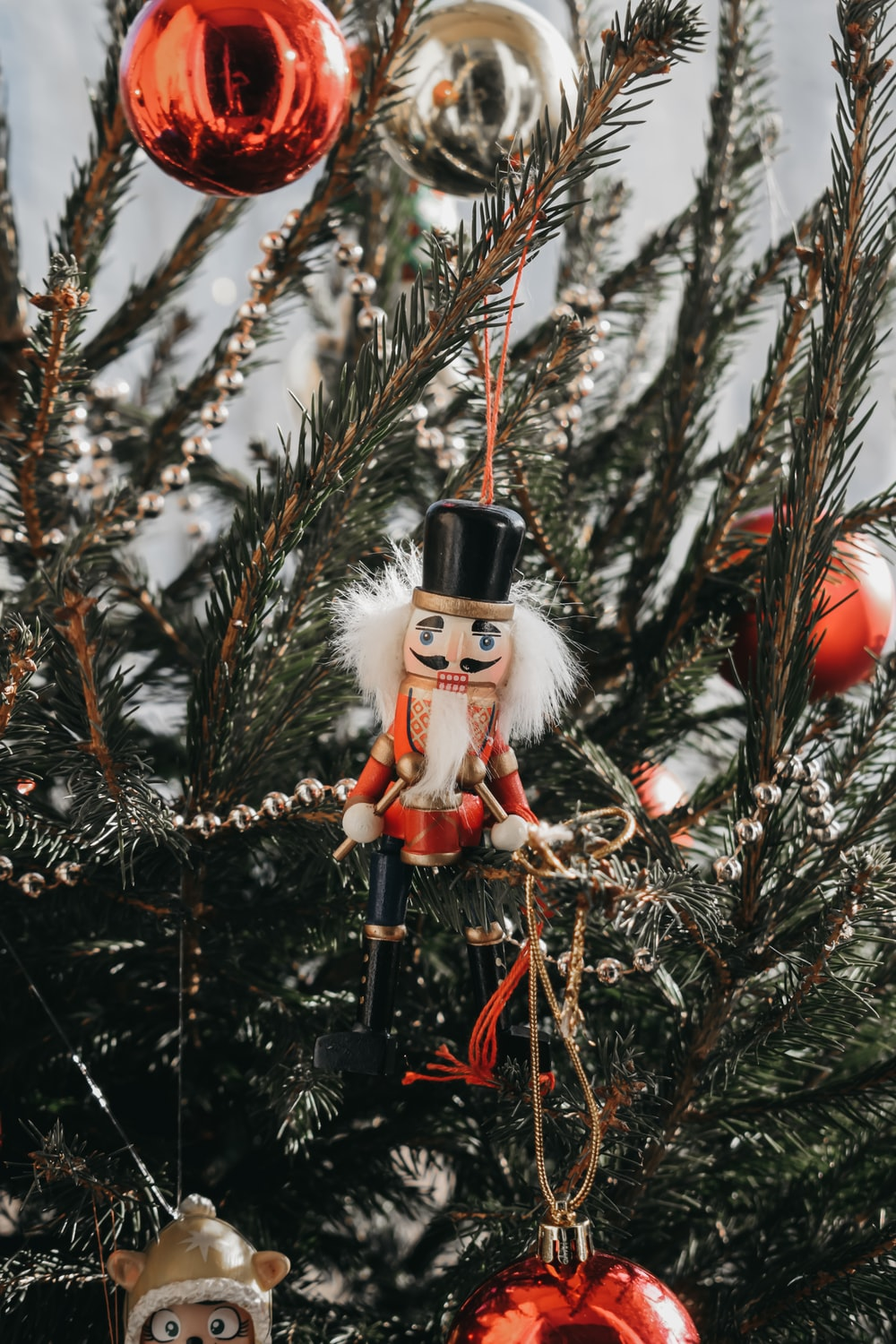 red and white snowman figurine