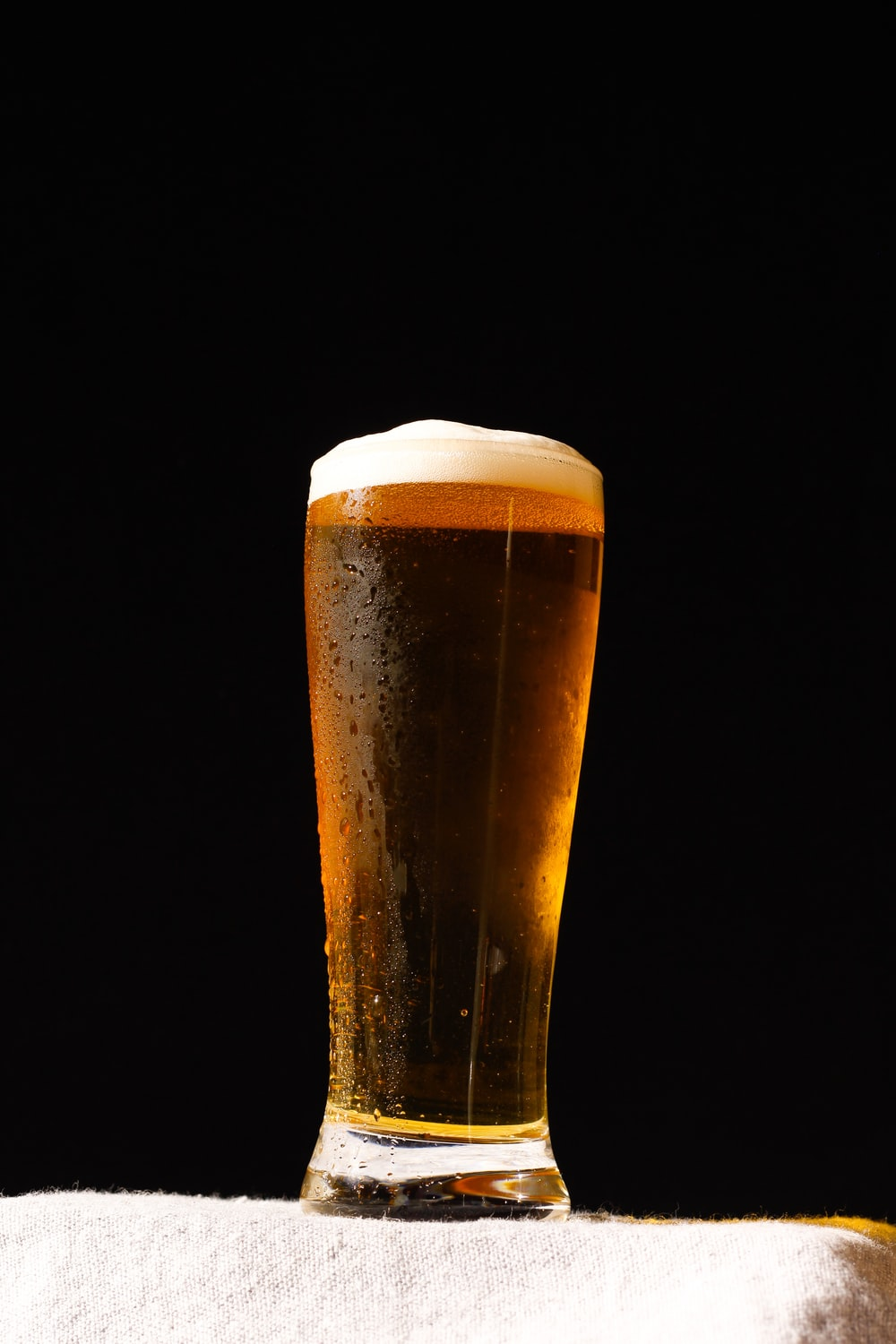clear drinking glass with beer