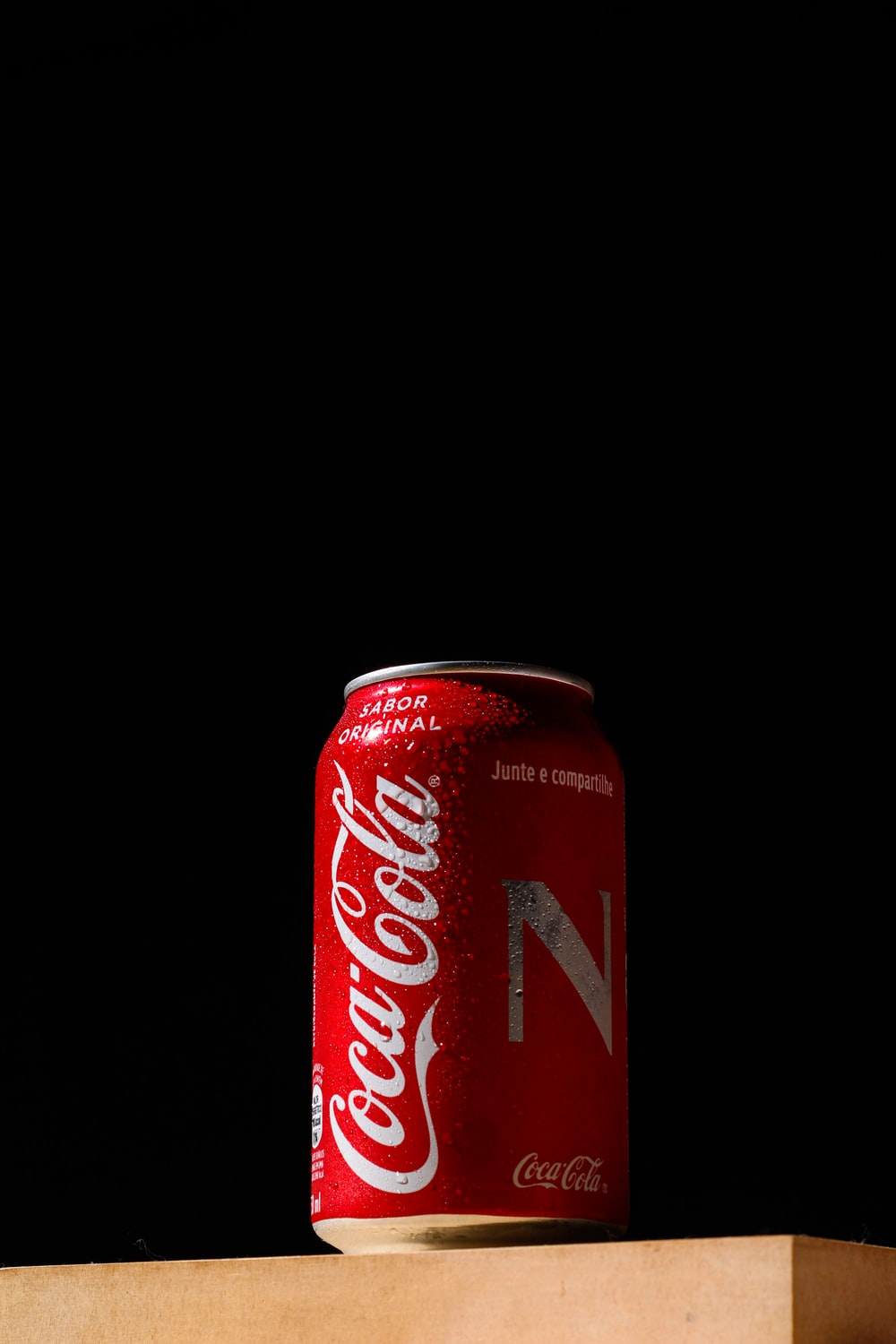 coca cola can on white surface