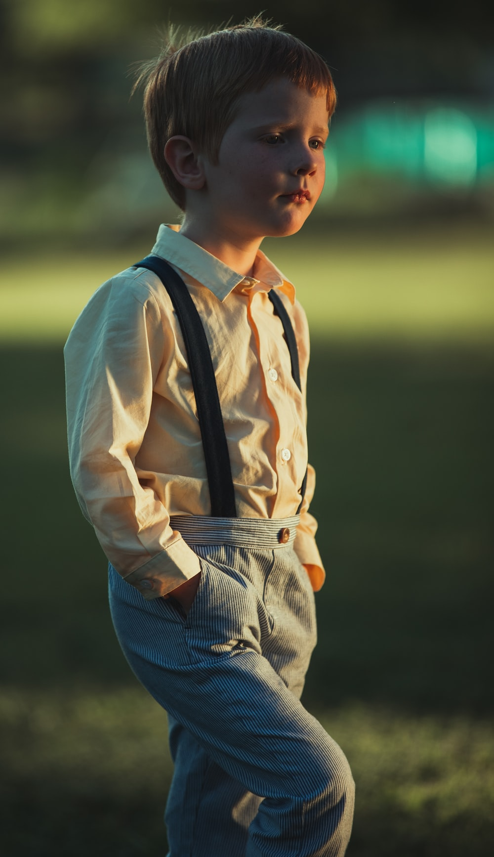 boy in white dress shirt and blue denim jeans