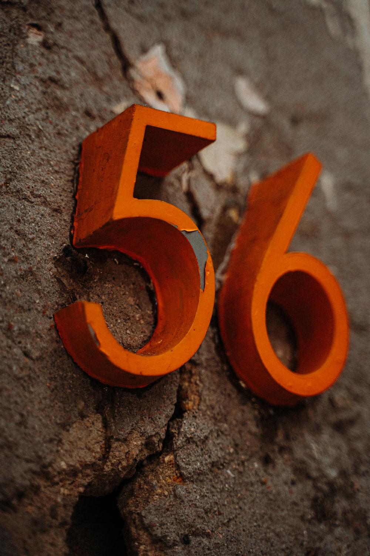 orange letter b on gray concrete surface
