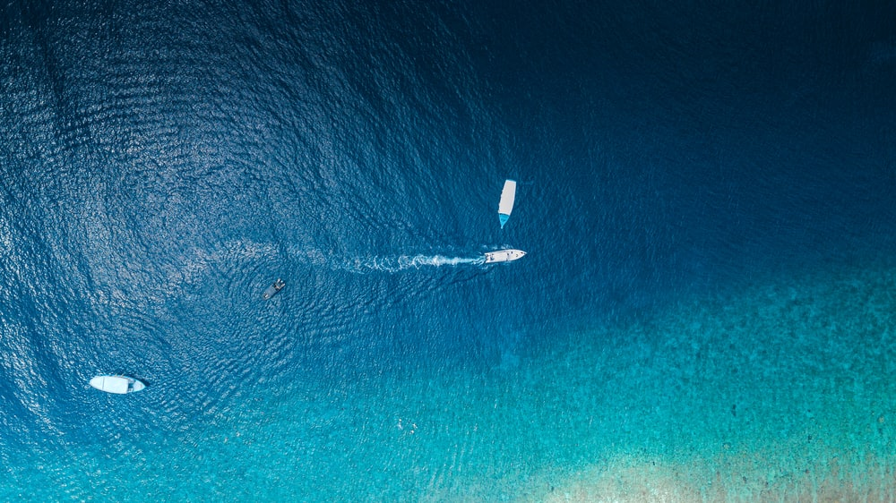 aerial view of boat on sea during daytime
