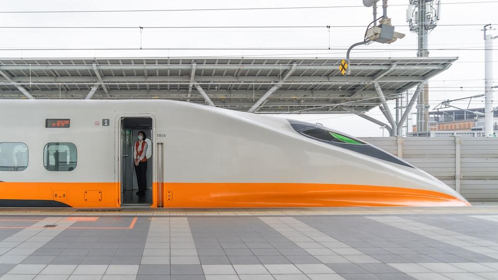 white orange and yellow train