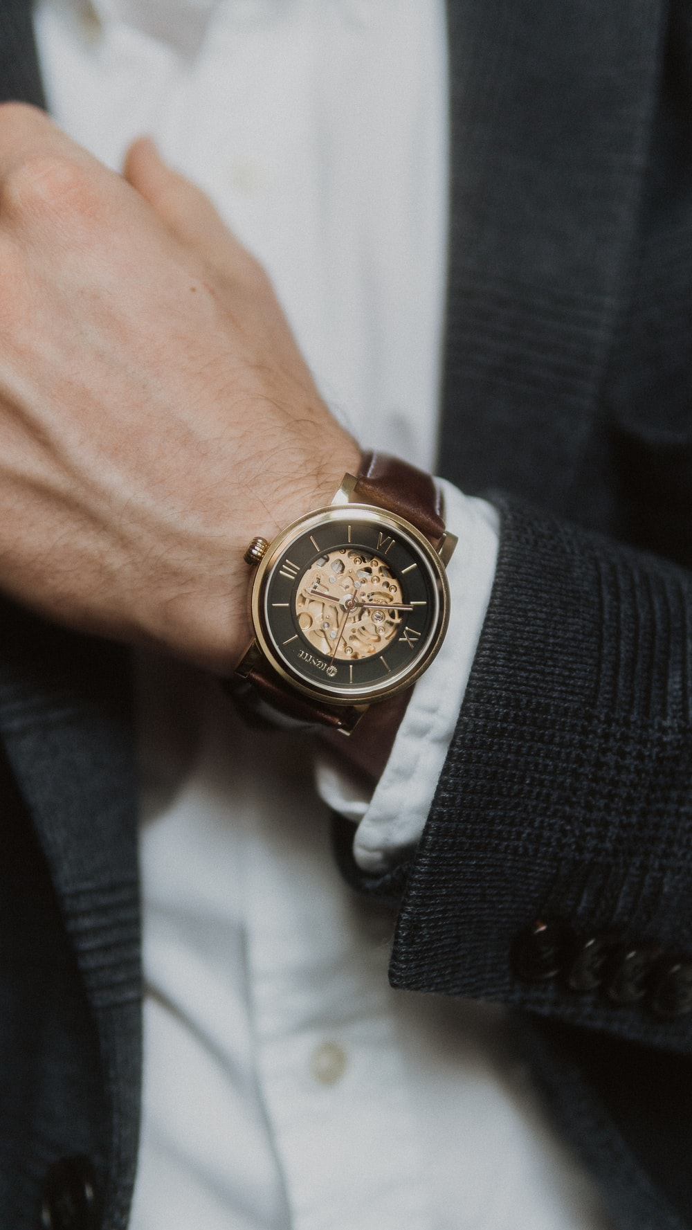 person wearing silver and gold chronograph watch