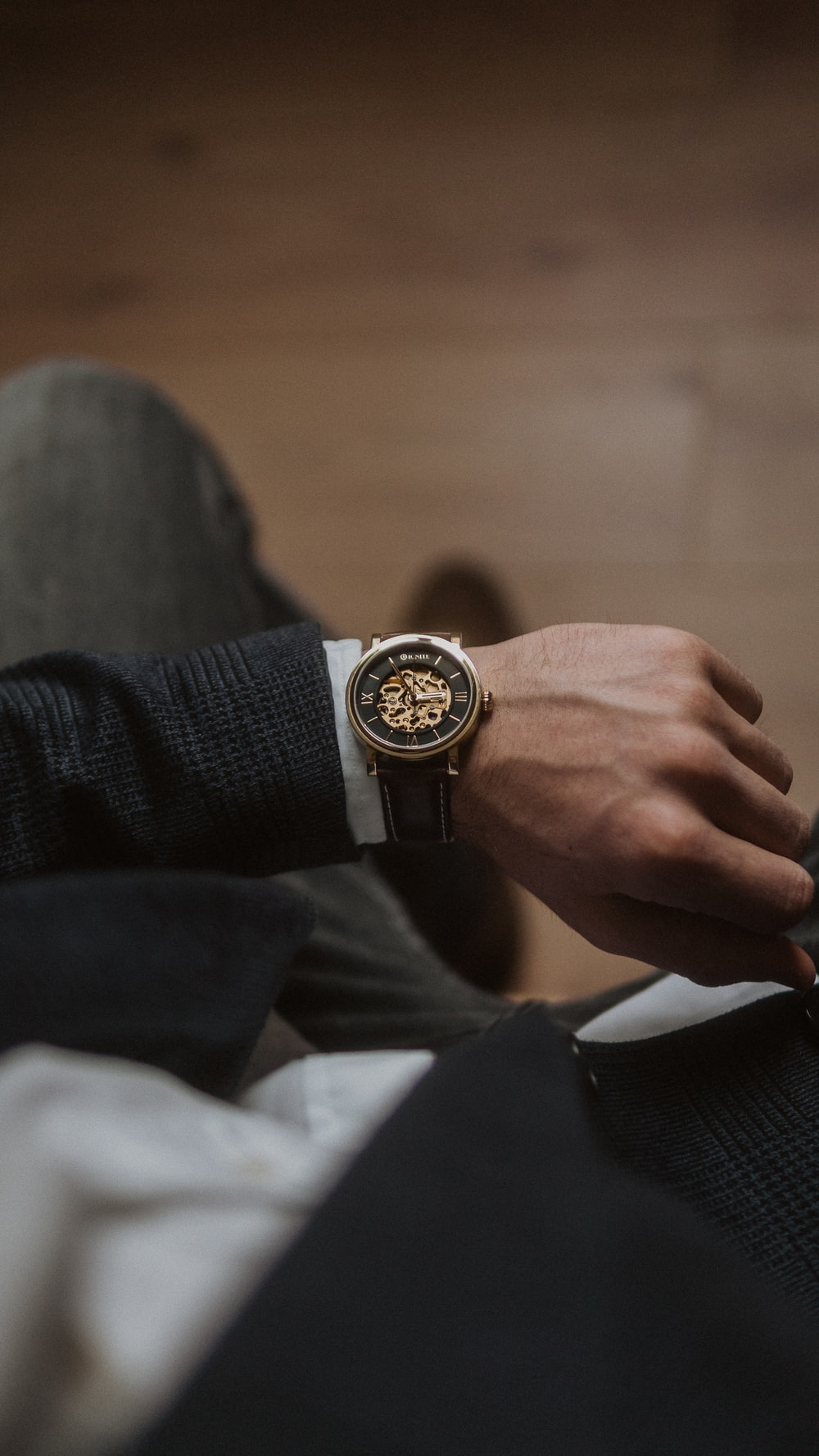 person wearing gold and silver round analog watch