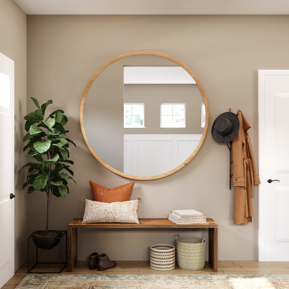 brown wooden framed mirror on white wall