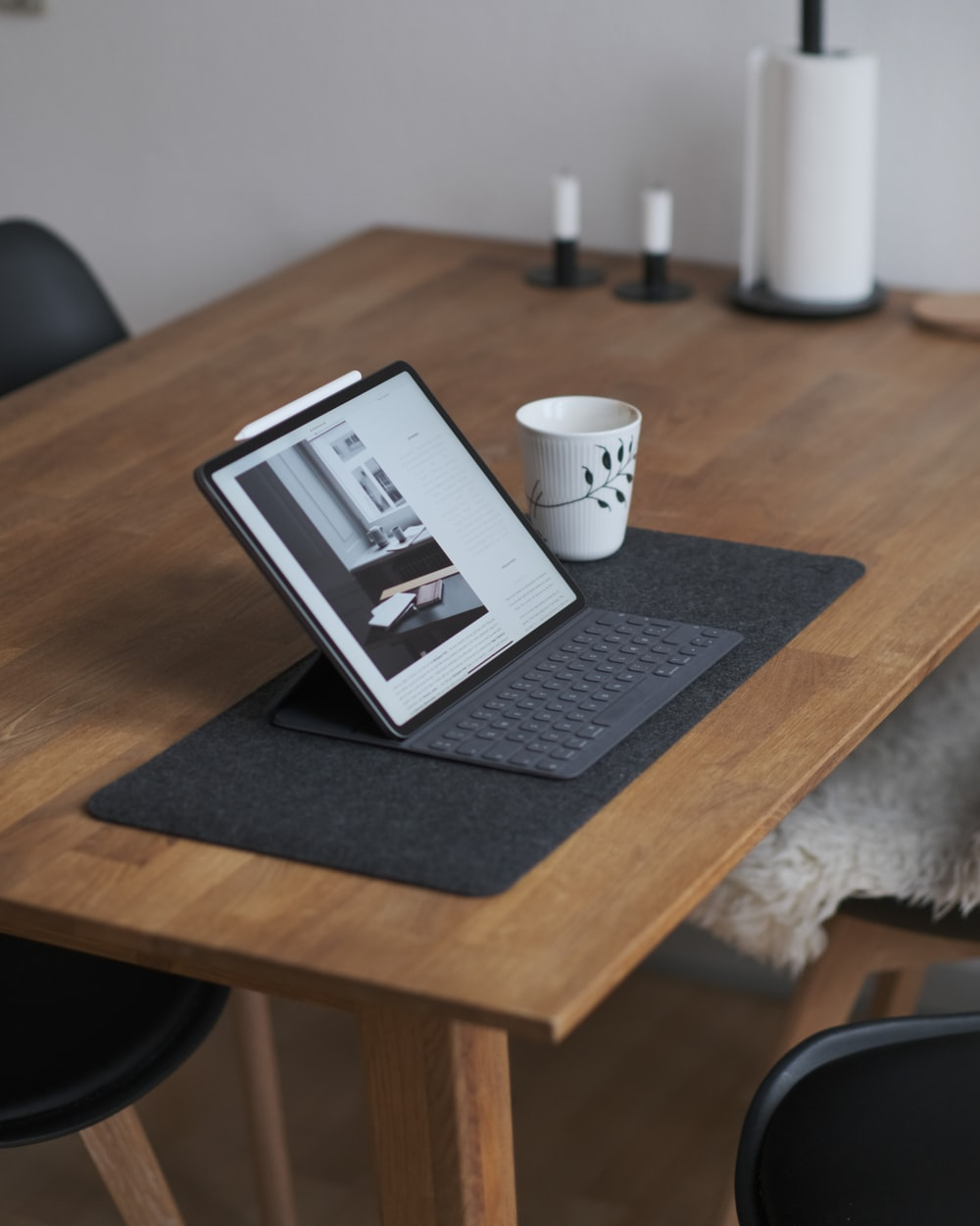 black tablet computer on brown wooden table