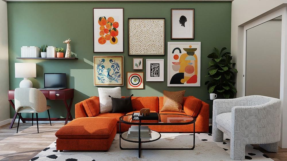orange and black sofa with throw pillows