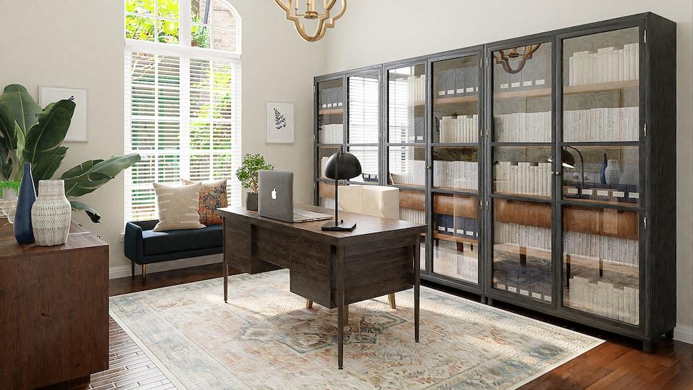 brown wooden table near brown wooden framed glass door