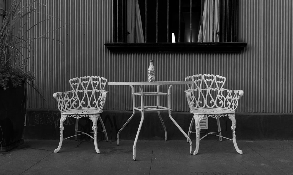 black metal table and chairs
