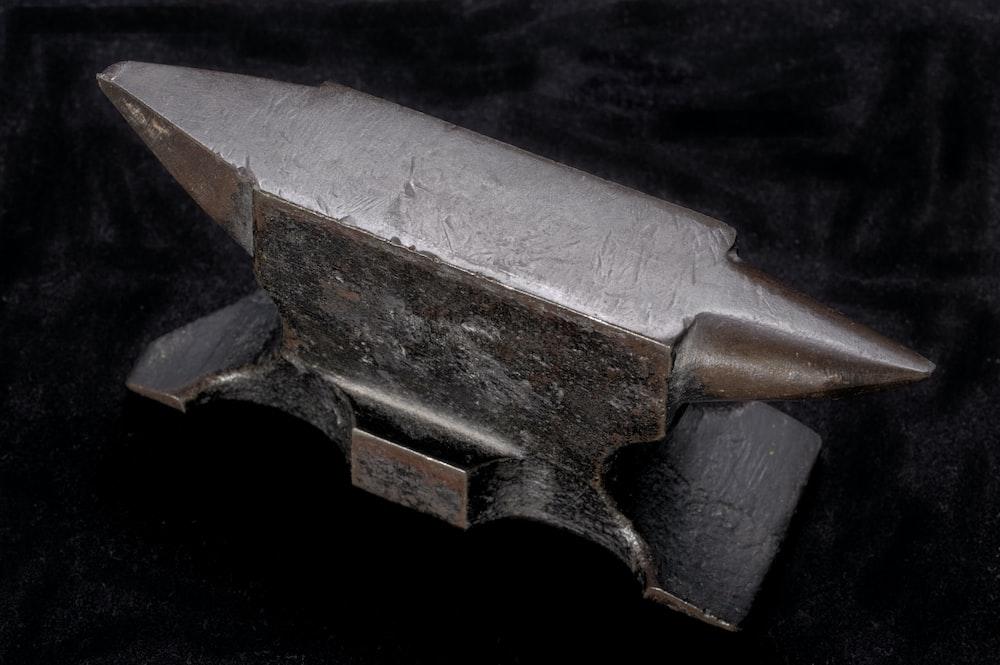 silver pistol on black textile