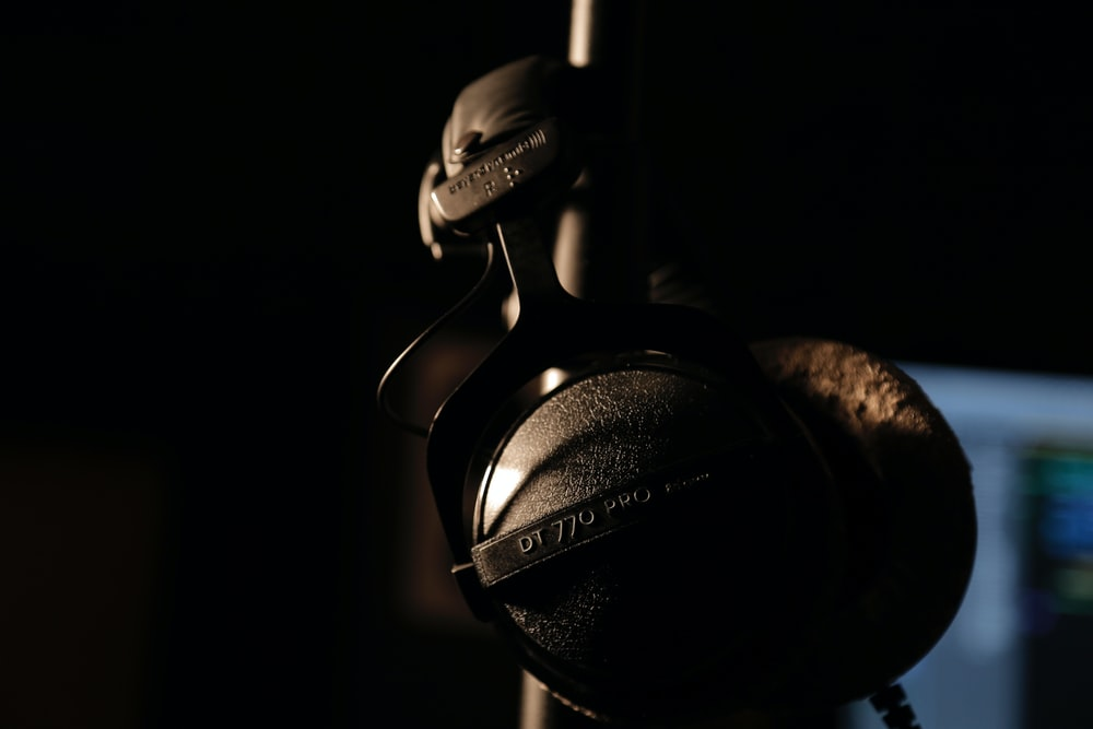 black and gray headphones on black background
