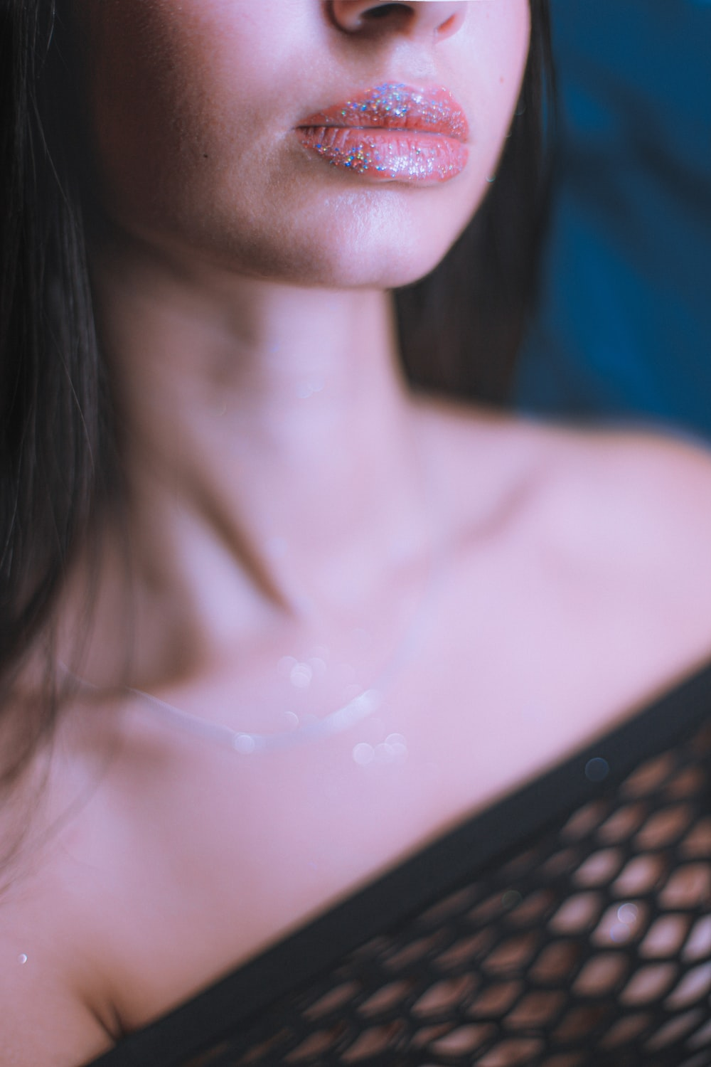 topless woman with silver necklace