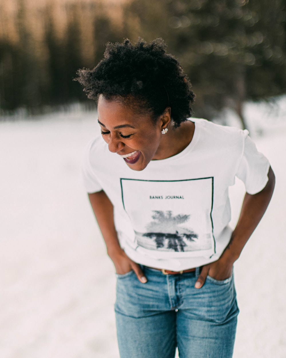 woman in white crew neck t-shirt and blue denim jeans