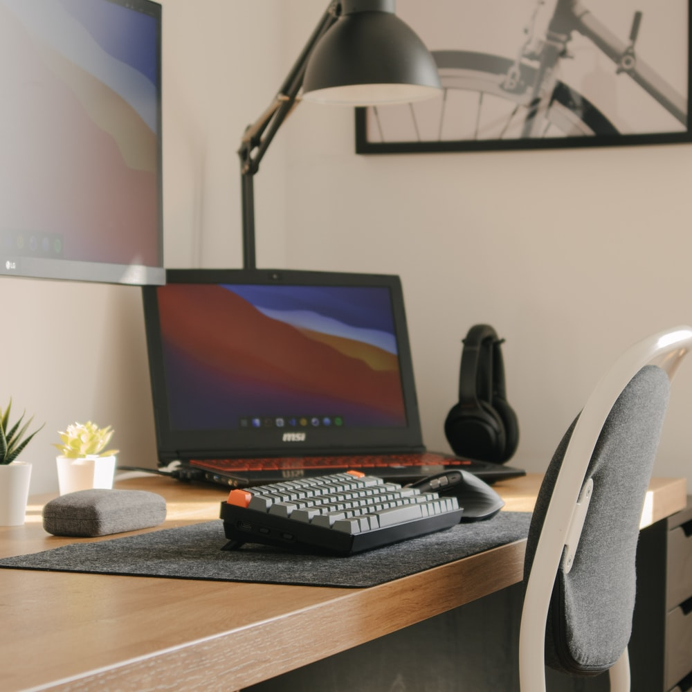 black flat screen computer monitor on brown wooden table