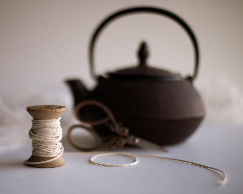 black teapot on white table